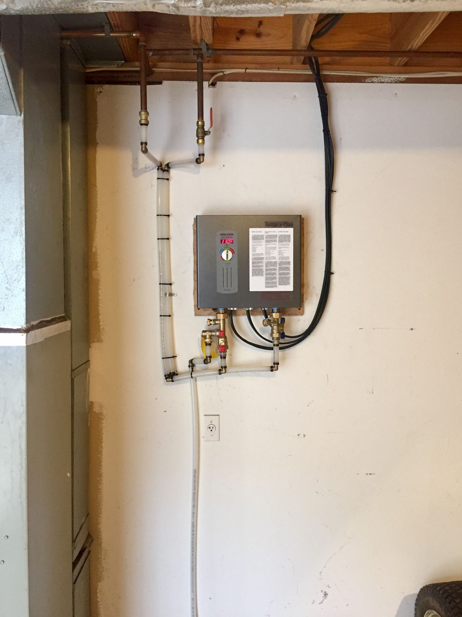 Douglas Cooling and Heating is installing a residential electric tankless water heater