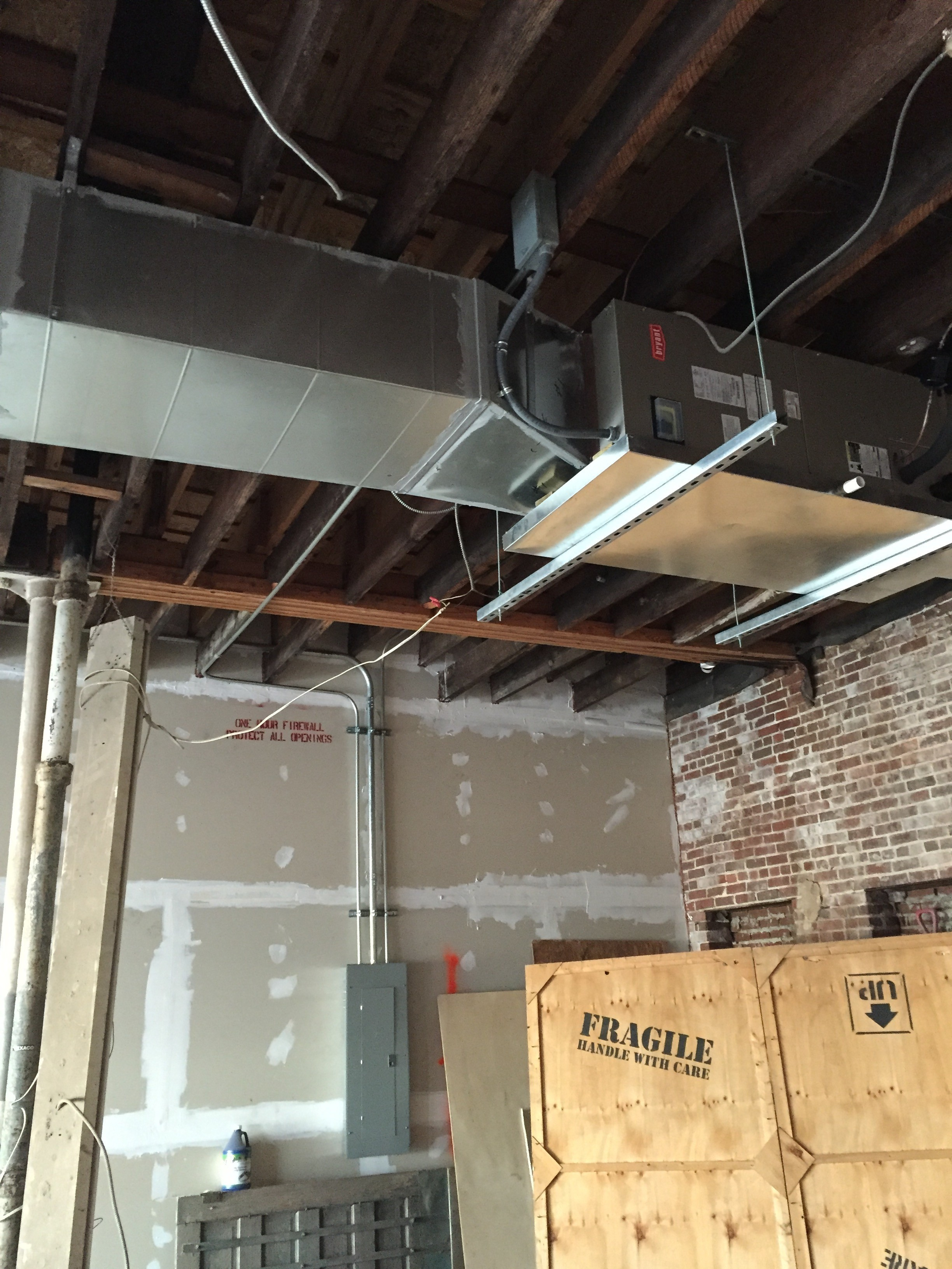 Douglas Cooling and Heating new construction installing new duct work and hanging an indoor unit